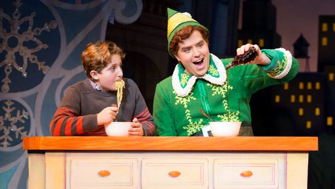 "Nicholas Canal (left) and Sam Hartley perform in the touring company of ""Elf: The Musical,"" which continues through Sunday at the Marcus Center, 929 N. Water St. in Milwaukee."