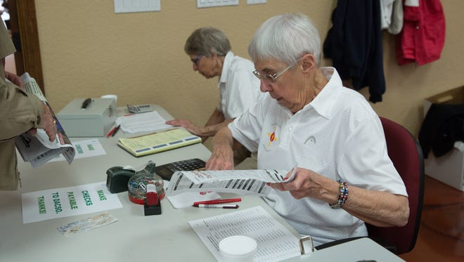 Marilyn Simione, right, and Fern Harrison,left, register people for the Senior Olympics, Saturday, February 18, 2017 at the Clubhouse of the Trail West.
