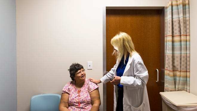 Vickie Bricker, 62, listens to nurse practitioner Sherry Nagle as she talks through her health concerns during an appointment at the Friendship Health Center in East Naples on Tuesday, July 11, 2017. The center operates as a collaboration between the Senior Friendship Center and Healthcare Network of Southwest Florida to provide primary care services and specialized care/social services to seniors.