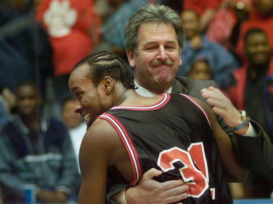Wilson boys basketball coach Chris Connell shares a hug with Lyonel Anderson after Wilson beat Franklin in the 2000 Class A championship