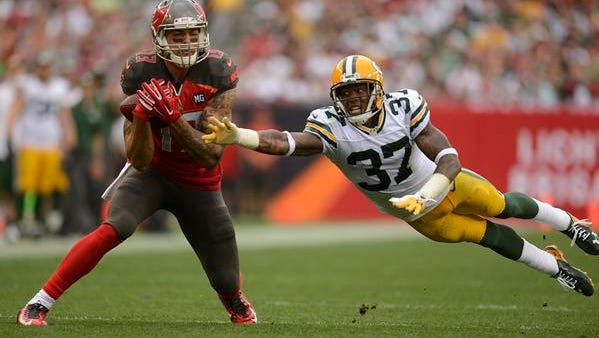 Green Bay Packers cornerback Sam Shields tries to break up a pass to Tampa Bay Buccaneers receiver Mike Evans during the first half of Sunday's game in Tampa, Fla.