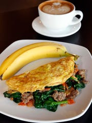 The omelet with sausage, tomatoes, spinach at Hebrews Coffee.