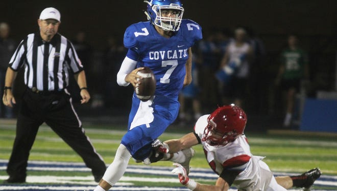 CovCath QB AJ Mayer escapes the grasp of Scott County's Cooper Watts.  Scott County at Covington Catholic football. Oct. 28, 2016. CovCath HS. Park Hills Ky.