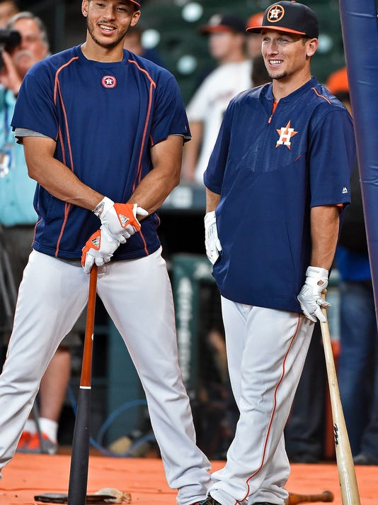 Houston Astros third baseman Alex Bregman, right, and shortstop Carlos Correa talk during batting practice before a baseball game against the New York Yankees, Monday, July 25, 2016, in Houston. (AP Photo/Eric Christian Smith)