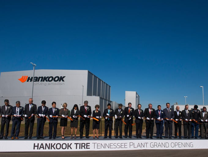 Executives and local leaders cut the ribbon during