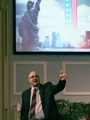 The Rev. Gary Click was the guest speaker Friday during a ceremony remembering the Sept. 11 attacks at Mansfield Baptist Temple.
