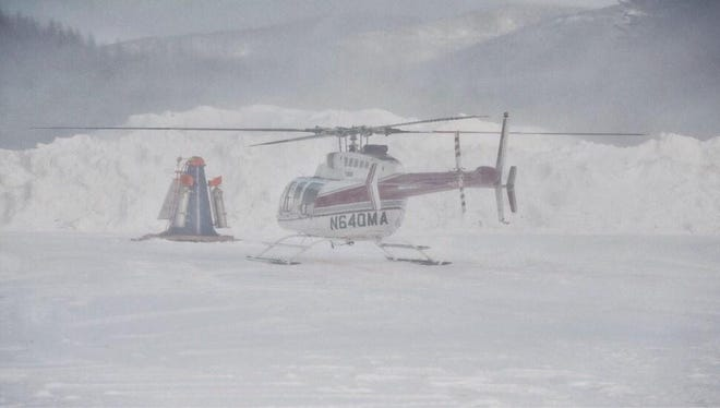 """BNFS personnel will look for slide paths from the air. Then they will attempt to trigger those slide paths a """"DaisyBell,"""" which uses a cylinder suspended form a helicopter that can be positioned above the snowpack."""