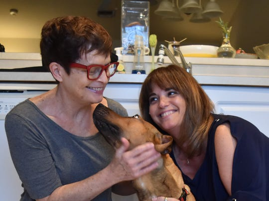 Mother and daughter Marilee DeJacimo, left, and Segal Adony pose with Mona, a 1-year-old pup, on June 13, 2017. Adony adopted Mona after she and her mom found her along the Tamiami Trail in Collier County.