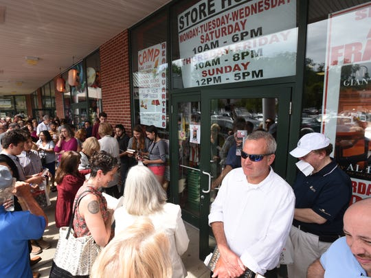 U.S. Senator Al Franken signs his new memoir at Books and Greetings in Northvale on Saturday July 29, 2017. A crowd gathers as they wait to have their books signed.