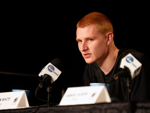 Iowa Hawkeyes forward Aaron White (30) speaks to media