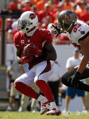 Arizona Cardinals cornerback Patrick Peterson (21) intercepts the ball in front of Tampa Bay Buccaneers wide receiver Vincent Jackson (83) during the fourth quarter at Raymond James Stadium in Tampa on Sept. 29, 2013. The Cardinals defeated the Buccaneers 13-10.