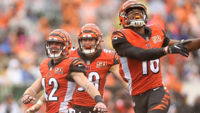 Cincinnati Bengals strong safety Clayton Fejedelem (42), left, and Cincinnati Bengals wide receiver Cody Core (16), right, react after a special teams play in the first quarter during the Week 5 NFL game between the Buffalo Bills and the Cincinnati Bengals, Sunday, Oct. 8, 2017, at Paul Brown Stadium in CIncinnati.