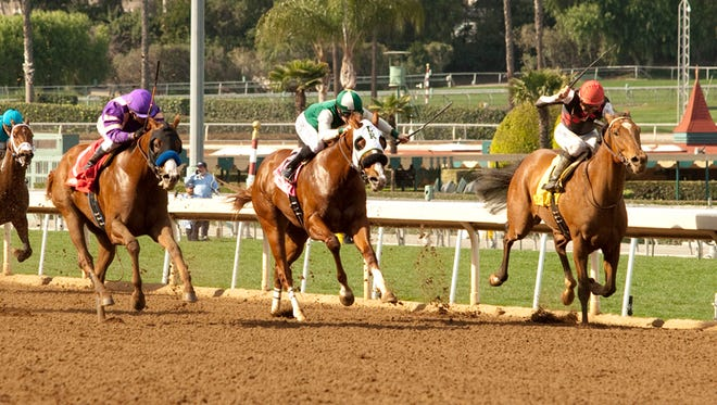 Breeders' Cup Juvenile winner Texas Red, shown in front on the rail, narrowly lost the San Vicente Feb. 1, but trainer Keith Desormeaux is looking down the road.