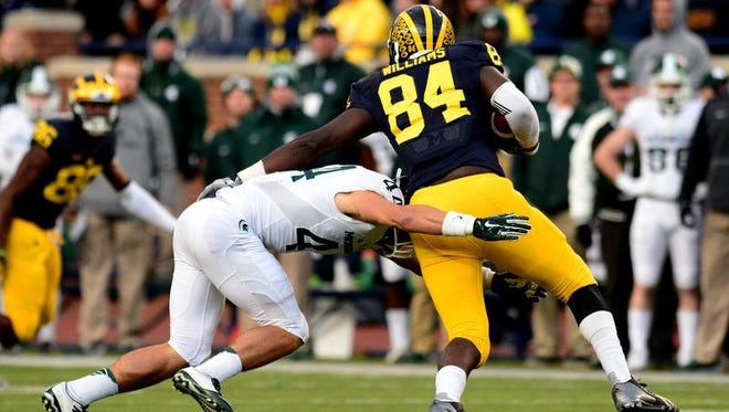 Michigan State safety Grayson Miller (44) tackles Michigan tight end A.J. Williams (84) in the third quarter of the Spartans' last-second 27-23 victory over Michigan Saturday, October 17, 2015 in Ann Arbor.