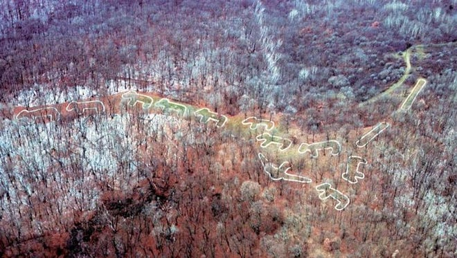 The bear grouping of effigy mounds is outlined in an aerial photograph at Effigy Mounds National Monument near Marquette, Iowa.
