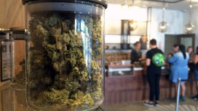 In this April, 2016 file photo, customers buy products at the Harvest Medical Marijuana Dispensary in San Fransisco