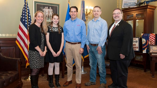 From left: Tania Haile, Hometown Hero Lia Haile, Wisconsin Gov. Scott Walker, Daniel Haile and State Rep. Paul Tittl following a meeting with the governor prior to Lia receiving the Hometown Hero Award from the Wisconsin State Assembly.