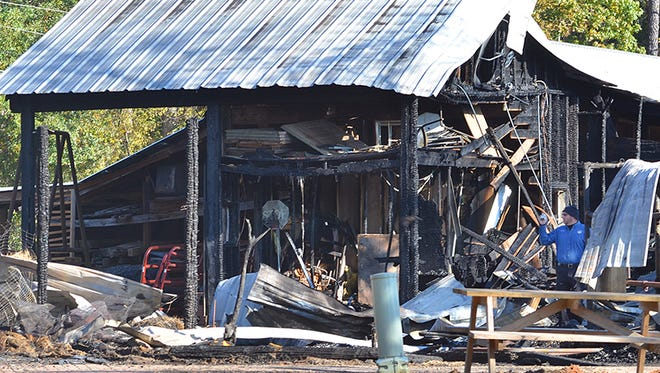 An investigator works the scene of Thursday's fire at the Mississippi Agriculture and Forestry Museum Friday morning on Lakeland Drive in Jackson.