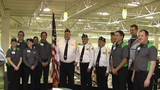The Color Guard from the Hawley-Dieckhoff American Legion Post 33 of Neenah helped the Neenah Festival Foods dedicate its new Veteran's Café. The café is a space in the store where military veterans can gather and spend time. Pictured from Post 33 Color Guard are, from left, Bruce Schinke, second vice commander; Bob Borszich, commander; Darnell Greening, first vice commander; and Clary Reinhardt, treasurer. Also pictured are members of the staff of the Neenah Festival Foods.