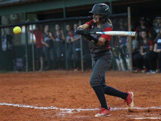 Wakulla's Caroline Barwick tries to slap a hit against Lincoln.