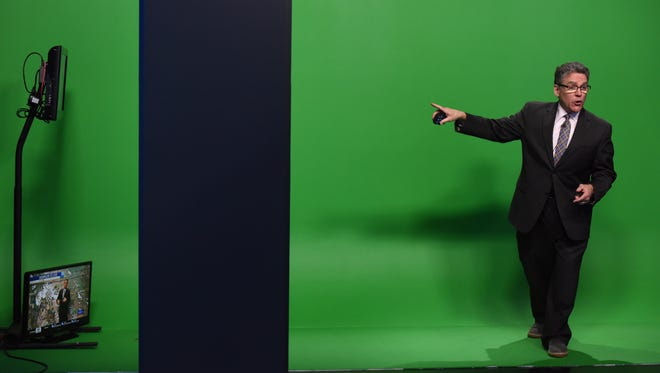 KSFY's senior meteorologist Phil Schreck forecasts the weather on a green screen during a 5 o'clock news last week.