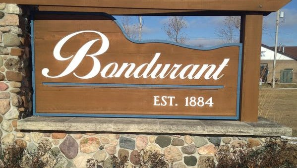 A sign welcomes visitors to Bondurant