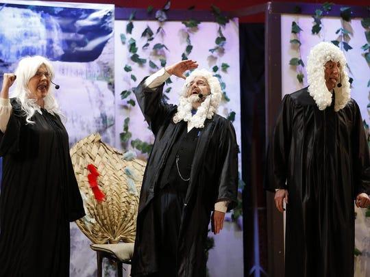 A trio of judges, played by Joe Edkin, Julie Hollerman