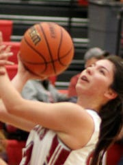 Lady Cat Brooke Huerta takes a hard drive to the basket