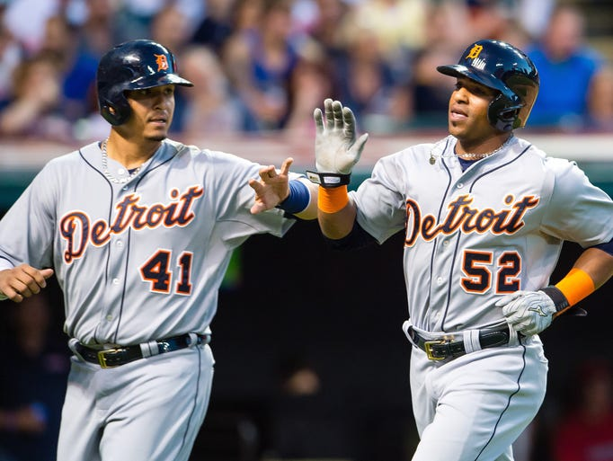 The Tigers'  Victor Martinez, left, and Yoenis Cespedes