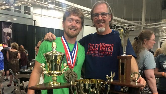 Chilly Water Brewing Co. head brewer Dan Krzywicki and owner Skip DuVall pose with their medals and trophies from the 2015 Indiana Brewers' Cup.