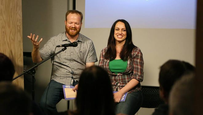 """Adam Kealoha Causey and Laura Carroll at a signing of their new book """"100 Things to Do in Las Vegas Before You Die"""" at the Writer's Block bookstore in Las Vegas, Nevada,"""