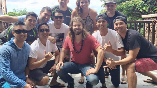 Gravity Payments CEO Dan Price with his Hawaii team.. (Photo: Gravity Payments.)