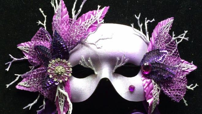 A Dennis Beckham custom Mardi Gras mask.