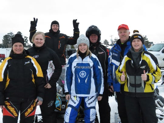 Angie, Jenniy and Jerry Mavis of Stevens Point and Wittenberg, Hanna Meronk of Stevens Point, Gary Tryba of Wittenberg, and Sonny and Kayliah Meronk of Rosholt during a break from riding in and around Vilas County during the 2015 MS Snowmobile Tour.