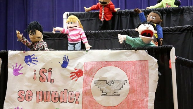 GABE HERNANDEZ/CALLER-TIMES Students from Dr. M.L. Garza-Gonzalez Charter School present a puppet theater presentation called 'César Chávez Comes to Visit' to honor the legacy of César Chávez on Friday, April 1, 2016, in Corpus Christi.