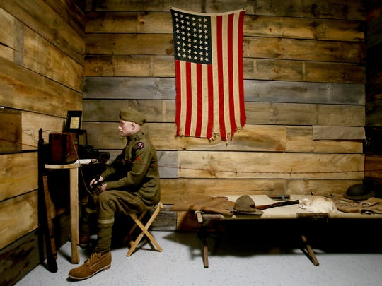 A replica of a typical room with a cot that soldiers