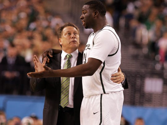 Michigan State head coach Tom Izzo talks with #23 Draymond Green during a time out in the second half.