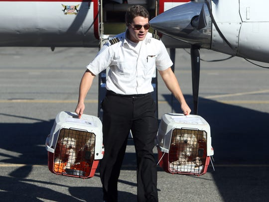 First Officer Brent Muno of Chicago helps to offload