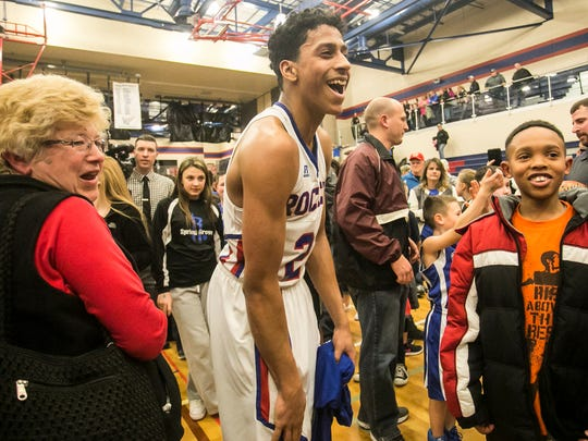 Spring Grove's Eli Brooks, talks with fans after his team defeated Northeastern 77-67 Friday, Jan. 27, 2017, at Spring Grove Area High School. Amanda J. Cain photo