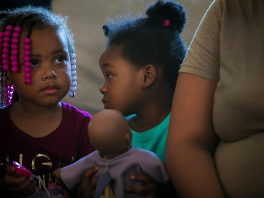 Three-year-old Jordan Hackett (center), remains traumatized seeing her brother shot a year ago.
