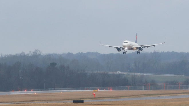 A pending contract to upgrade Runway 4-22 at the Tuscaloosa National Airport will remove the need for waivers that are now required for the landing of large planes like the Delta aircraft carrying the University of Alabama football team, seen here in a January 2018 file photo.