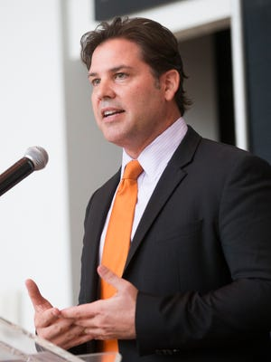 Phoenix Suns president Jason Rowley reveals a new arena naming rights partner for the home of the Suns and Mercury during a press conference at US Airways Center in Phoenix December 2, 2014.