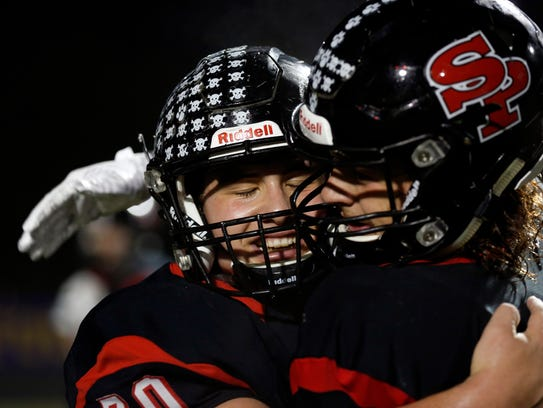 SPASH players hug after defeating Fond du Lac to move