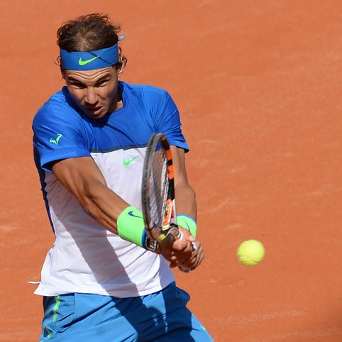 Rafael Nadal of Spain in action against Pablo Cuevas of Uruguay during their quarterfinal match at the Hamburg Open.