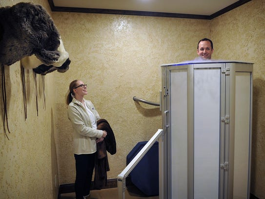Cryotherapy technician Jessica Smith talks with Matt