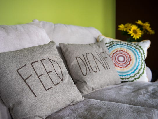 Cushions with ComeUnity's Cafe's slogan, 'Love, feed,