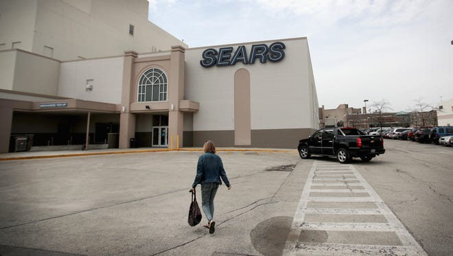 Customers shop at Chicago's last remaining Sears store May 3, 2018 in Chicago. The store, which opened in 1938, is scheduled to close in July. Sears opened its first retail store in Chicago in 1925.