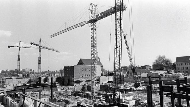 March 27, 1978 - Three tower cranes and two regular cranes were in place at 201 Poplar Avenue on March 27, 1978, as the Criminal Justice Complex began to rise out of the ground between Third and Fourth Streets in Downtown Memphis.  This photograph was taken looking toward the southeast.