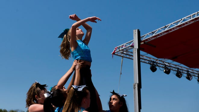 Haven Roy, 11, is lifted into the air by her fellow dancers during a contemporary dance performance with Cast and Crowns at Riverfest.