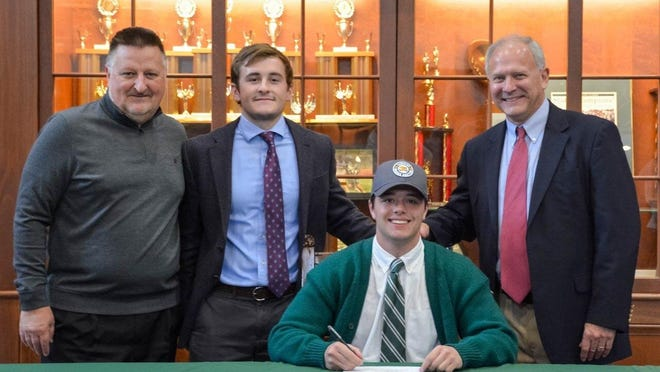 Noah Goad, seated, a 2020 Western Reserve Academy graduate, signed a national letter of intent to continue his academic and lacrosse careers at Canisius College in Buffalo, New York. Also pictured are, from left, WRA director of athletics Herb Haller, former Pioneers head boys lacrosse coach CJ Polak and Reserve assistant ice hockey coach Jeff Warner.